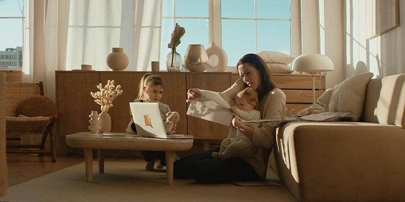 Women working in her living room with two children