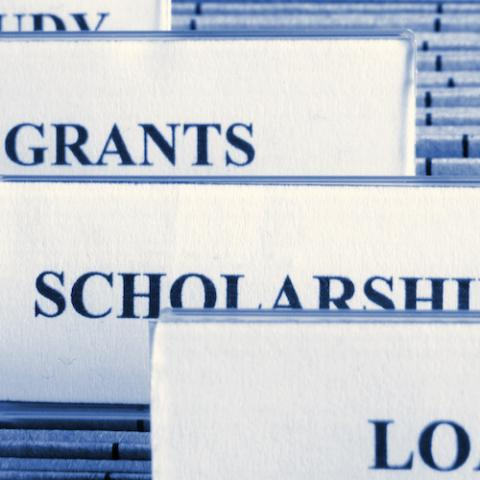 Hanging folders with labels: Loans, Grants, Scholarships, Work Study